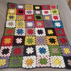 Hand crocheted multi color baby blanket